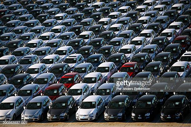 Rows of new cars at car factory parking, elevated view (full frame)