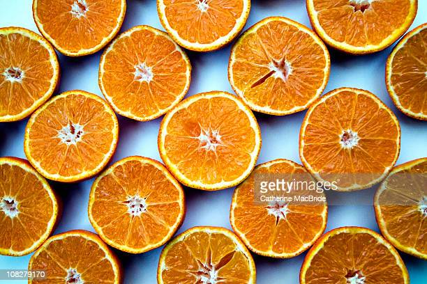 rows of orange halves - catherine macbride stock pictures, royalty-free photos & images