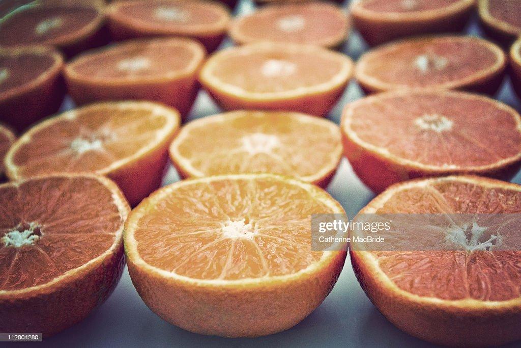 Rows of orange halves : Stock Photo