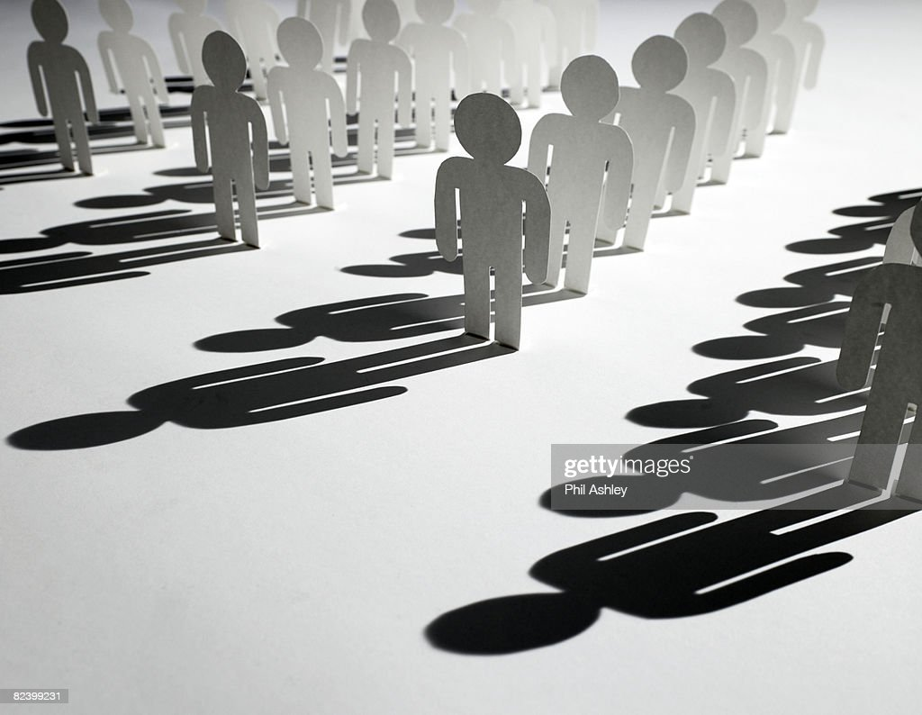 rows of paper people : Stock Photo