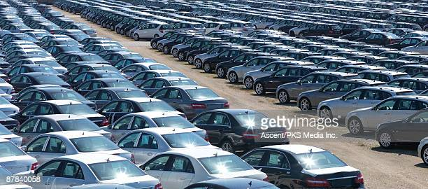 Rows of parked new cars in outdoor yard