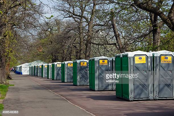 rows of portable toilets for the london marathon - portable toilet stock photos and pictures