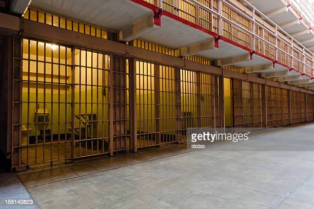 rows of prison cells - prison cell stock pictures, royalty-free photos & images