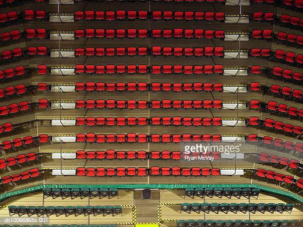 Rows of red chairs in stadium, elevated view
