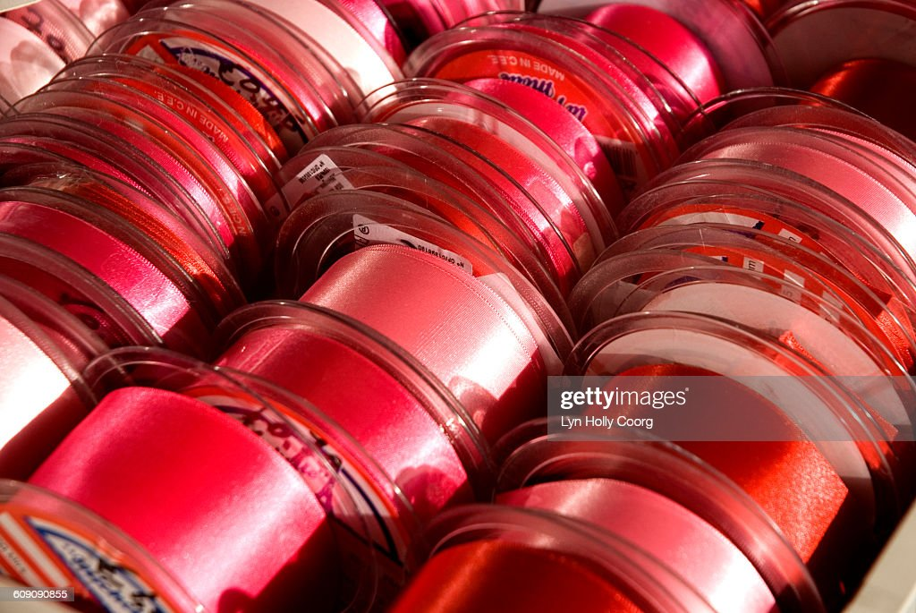 Rows of red ribbon for sale : Stock Photo