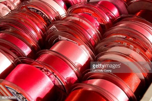 rows of red ribbon for sale - lyn holly coorg stock pictures, royalty-free photos & images