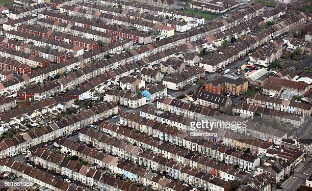 Rows of residential houses stand in this aerial photograph taken over Bristol UK on Thursday Dec 17 2015 UK asking prices rose an annual 74 percent...