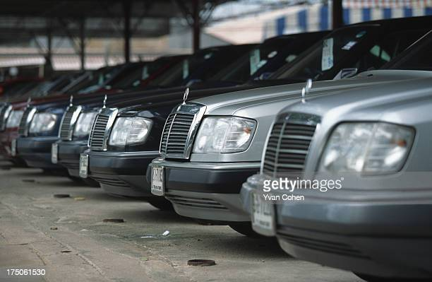 Rows of secondhand mercedes lined up for sale in Bangkok Many people had to sell their luxury cars after Thailand's economy collapsed in July 1997