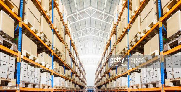rows of shelves with boxes in modern warehouse - storage compartment stock pictures, royalty-free photos & images