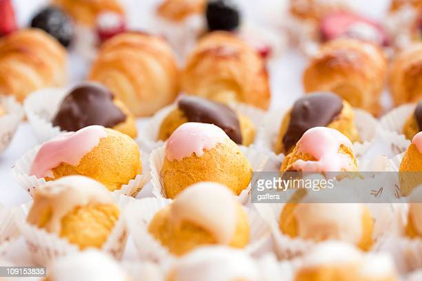 Rows of small Italian pastries in white cake cases