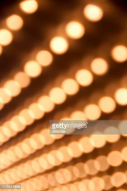 Rows of softened Defocused theater marquee lights