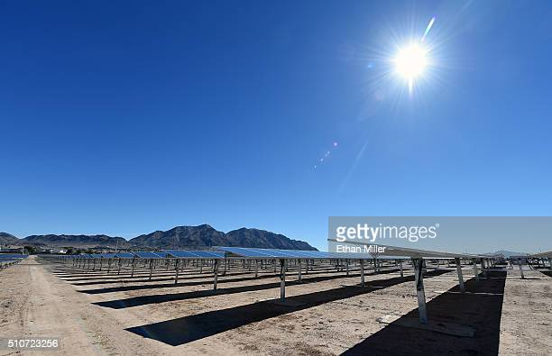 Rows of solar panels operate during a dedication ceremony to commemorate the completion of the 102acre 15megawatt Solar Array II Generating Station...