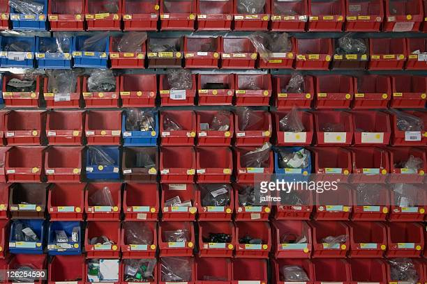 rows of spare parts storage tubs in red and blue - nut fastener stock photos and pictures