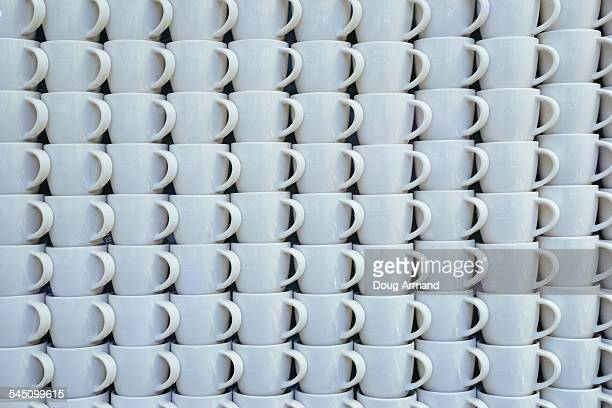Rows of stacked white coffee cups