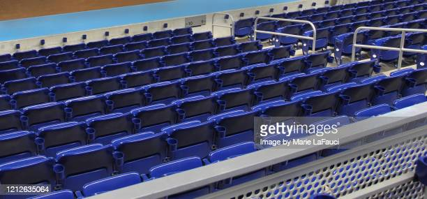 rows of stadium seats with cup holders - fauci stock pictures, royalty-free photos & images