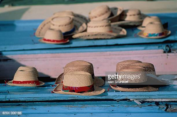 rows of straw hats - sirulnikoff stock pictures, royalty-free photos & images