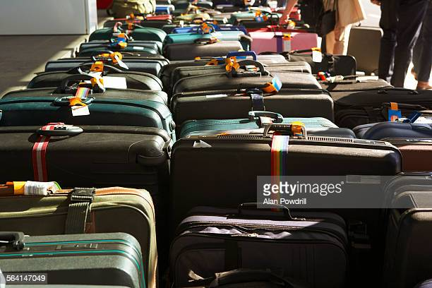 Rows of suitcases in airport