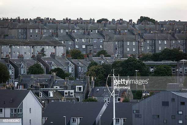 Rows of terraced residential properties stand on a hill near Aberdeen Harbour operated by the Aberdeen Harbour Board in Aberdeen UK on Friday Aug 8...