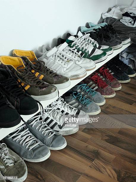 Rows of trainers against a wall