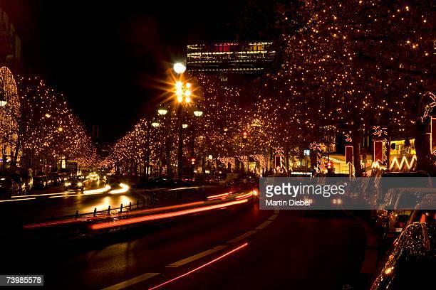 Rows of trees with Christmas lights along Kurfurstendamm, Berlin, Germany