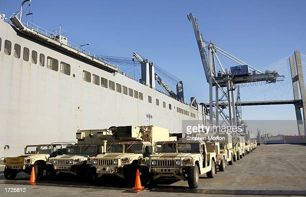 Rows of US Army Humvees and other vehicles sit on a dock January 14 2003 at the Port of Savannah Georgia The vehicles were waiting to be loaded...