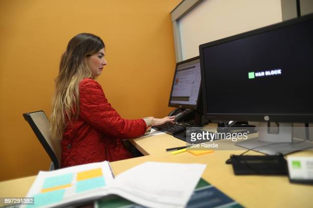 Roxana Butron HR Block Master Tax Advisor uses her computer to take a continuing tax code education course on the day President Donald Trump signed...