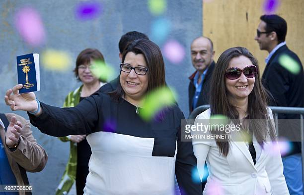 Roxana Ortiz and Virginia Gomez show their Civil Marriage document at the Registry Office in Santiago on Octubre 22 2015 The Chilean government...