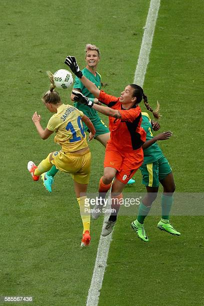 Roxanne Barker of South Africa defends the goal against Sofia Jakobsson of Sweden during the Women's Group E first round match between Sweden and...