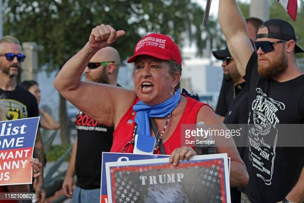 Roxanne Greene shouts support for President Donald Trump outside of the Adrienne Arsht Center for the Performing Arts in Miami on Wednesday June 26...