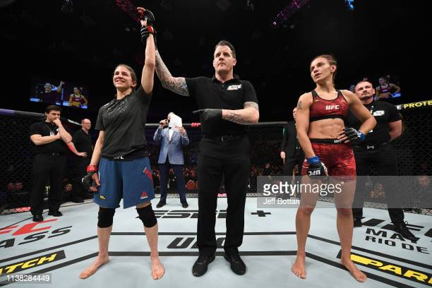 Roxanne Modafferi celebrates her victory over Antonina Shevchenko of Kyrgyzstan in their women's flyweight bout during the UFC Fight Night event at...