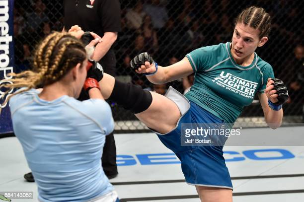 Roxanne Modafferi kicks Nicco Montano in their women's flyweight championship bout during the TUF Finale event inside Park Theater on December 01...