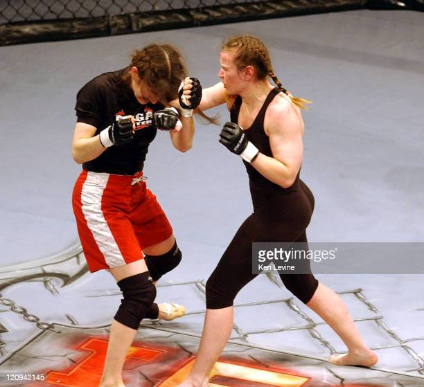 Roxanne Modafferi left is hit by a punch by IFC Womans World Middleweight Champion Jennifer Howe rightduring the IFC Caged Combat fights at the E...