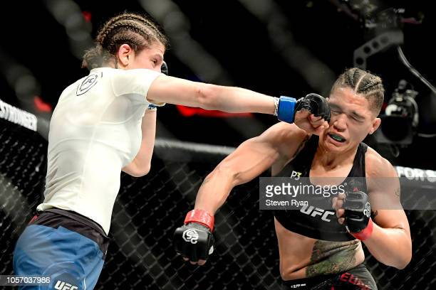 Roxanne Modafferi of the United States fights against Sijara Eubanks of the United States in their women's flyweight bout during the UFC 230 event at...