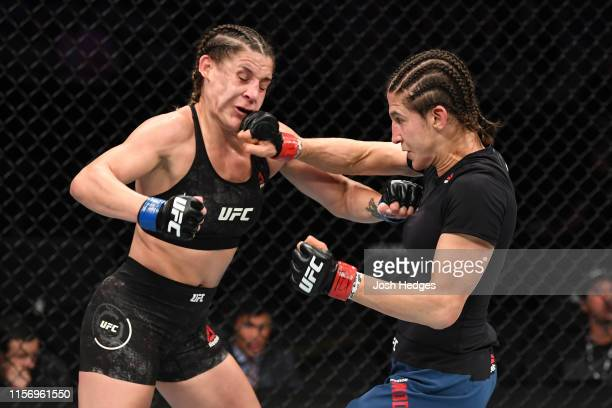 Roxanne Modafferi punches Jennifer Maia of Brazil in their women's flyweight bout during the UFC Fight Night event at ATT Center on July 20 2019 in...