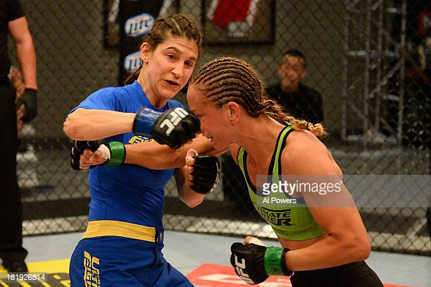 Roxanne Modafferi punches Jessica Rakoczy in their preliminary fight during filming of season eighteen of The Ultimate Fighter on June 12 2013 in Las...