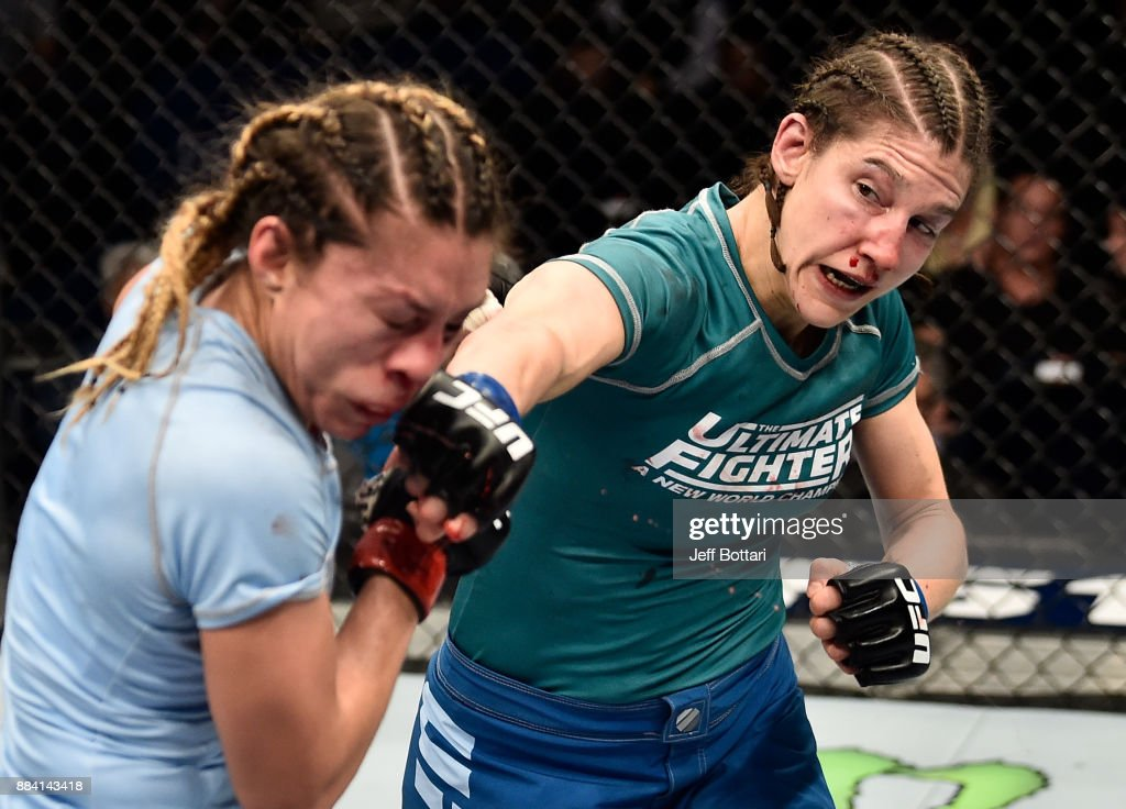 Roxanne Modafferi punches Nicco Montano in their women's flyweight championship bout during the TUF Finale event inside Park Theater on December 01, 2017 in Las Vegas, Nevada.