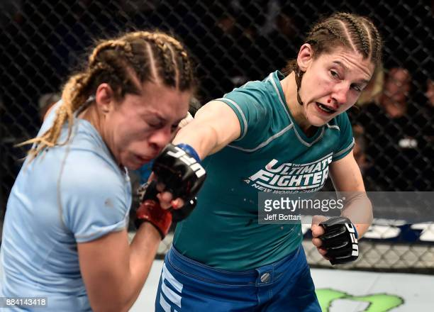 Roxanne Modafferi punches Nicco Montano in their women's flyweight championship bout during the TUF Finale event inside Park Theater on December 01...