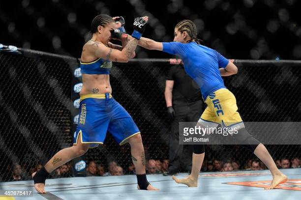 Roxanne Modafferi punches Raquel Pennington in their women's bantamweight fight during The Ultimate Fighter season 18 live finale inside the Mandalay...