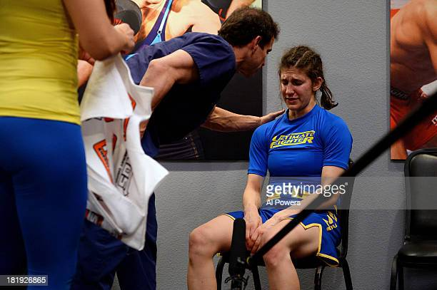 Roxanne Modafferi receives medical attention after being defeated by Jessica Rakoczy in their preliminary fight during filming of season eighteen of...