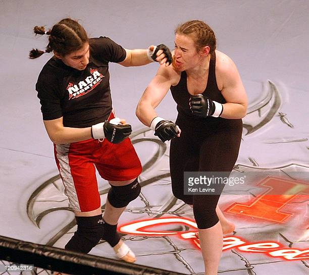 Roxanne Modafferilefttand IFC Womans World Middleweight Champion Jennifer Howe rightexchange punches during the IFC Caged Combat fights at the E...