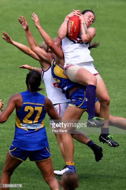 Roxanne Roux of the Dockers marks the ball during the round six AFLW match between the West Coast Eagles and the Fremantle Dockers at Optus Stadium...