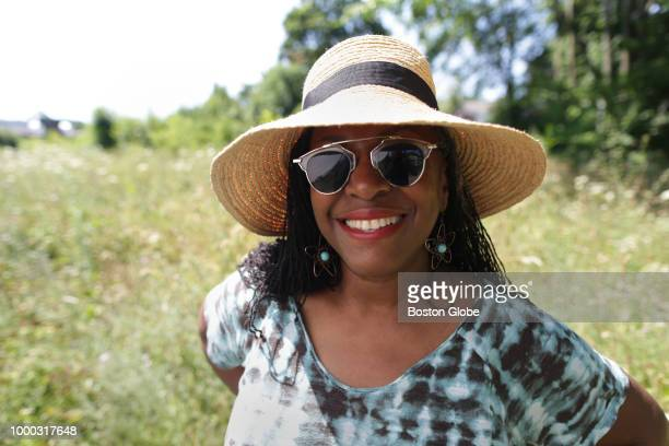 Roxbury artist Ekua Holmes poses for a portrait in Boston on July 10 2018 Holmes' Roxbury Sunflower Project aims to plant 10000 sunflowers all over...