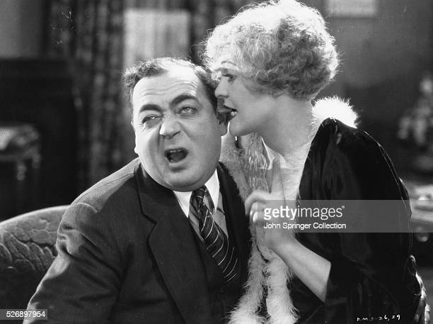 Roxie Hart bites her husband Amos' ear in a scene from Chicago .
