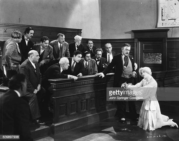 Roxie Hart pleads with the jury during her murder trial as her lawyer Flynn looks on in a scene from Chicago .