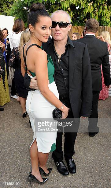 Roxie Nafousi and Damien Hirst attend the annual Serpentine Gallery Summer Party co-hosted by L'Wren Scott at The Serpentine Gallery on June 26, 2013...