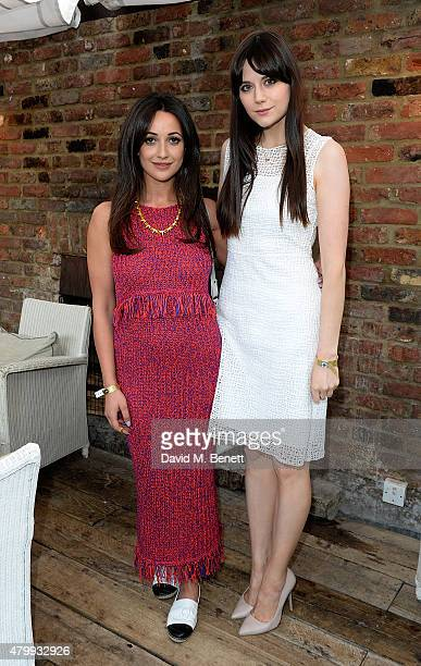 Roxie Nafousi and Lilah Parsons attend the Warner Summer Party in association with British GQ at Shoreditch House on July 8 2015 in London England