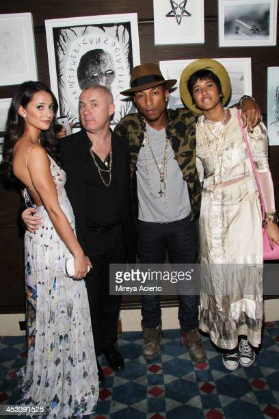 Roxie Nafousi Damien Hirst Pharrell Williams and Helen Lasichanh at the Tracey Emin dinner hosted by Phillips and Vanity Fair at Cecconi's at Soho...