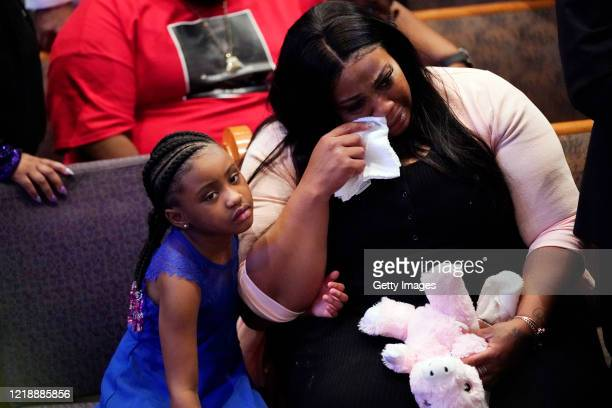 Roxie Washington and Gianna Floyd daughter of George Floyd attend the funeral service in the chapel at the Fountain of Praise church June 9 2020 in...