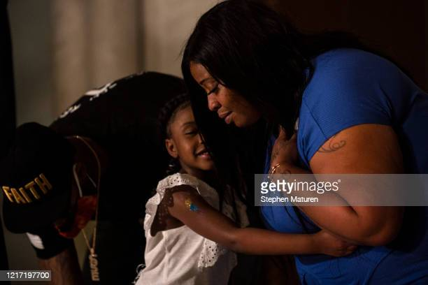 Roxie Washington embraces her daughter Gianna Floyd at a press conference on June 2, 2020 in Minneapolis, Minnesota. Washington was joined by Floyd's...
