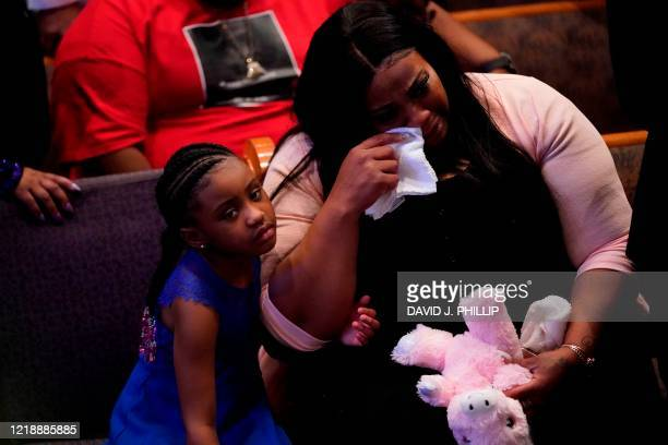 TOPSHOT Roxie Washington holds Gianna Floyd the daughter of George Floyd as they attend the funeral service for George Floyd at The Fountain of...